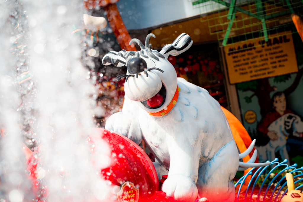 Comic dogs frolic around the fire hydrant in Toon Lagoon, Islands of Adventure