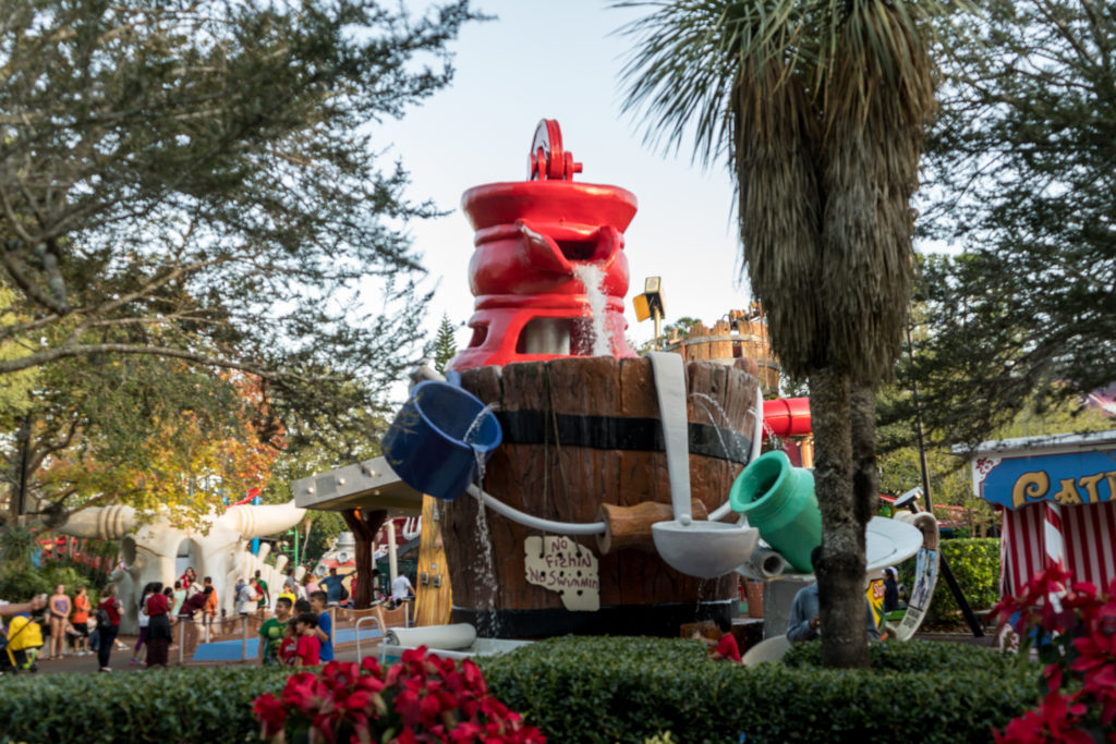 A giant bucket leaks water into various contraptions, where kids can splash and play