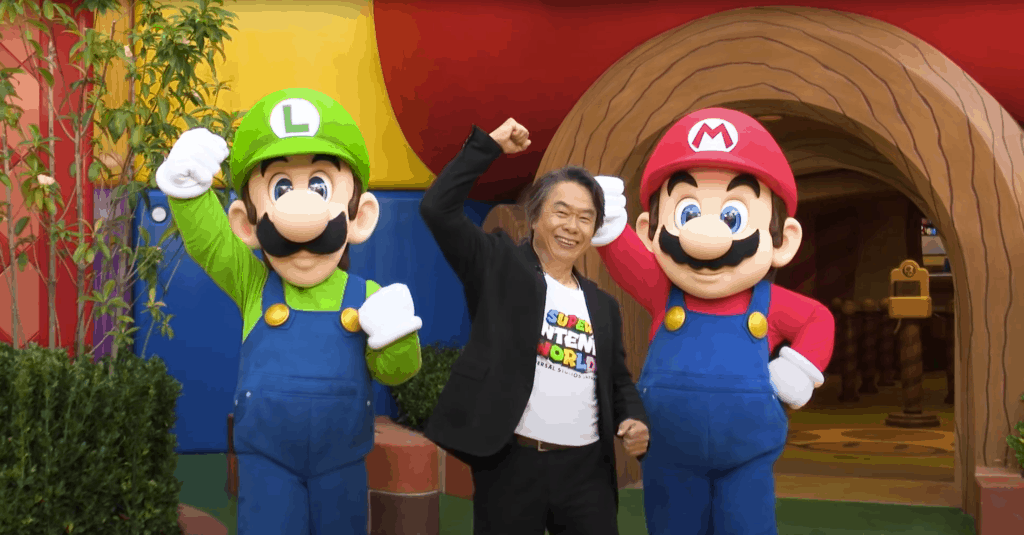 Shigeru Miyamoto with Mario and Luigi at Super Nintendo World