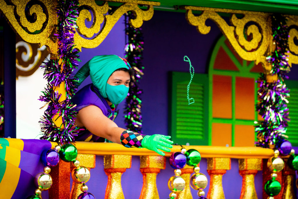 A performer handing out beads at the Miss New Orleans steamboat float at Mardi Gras 2021