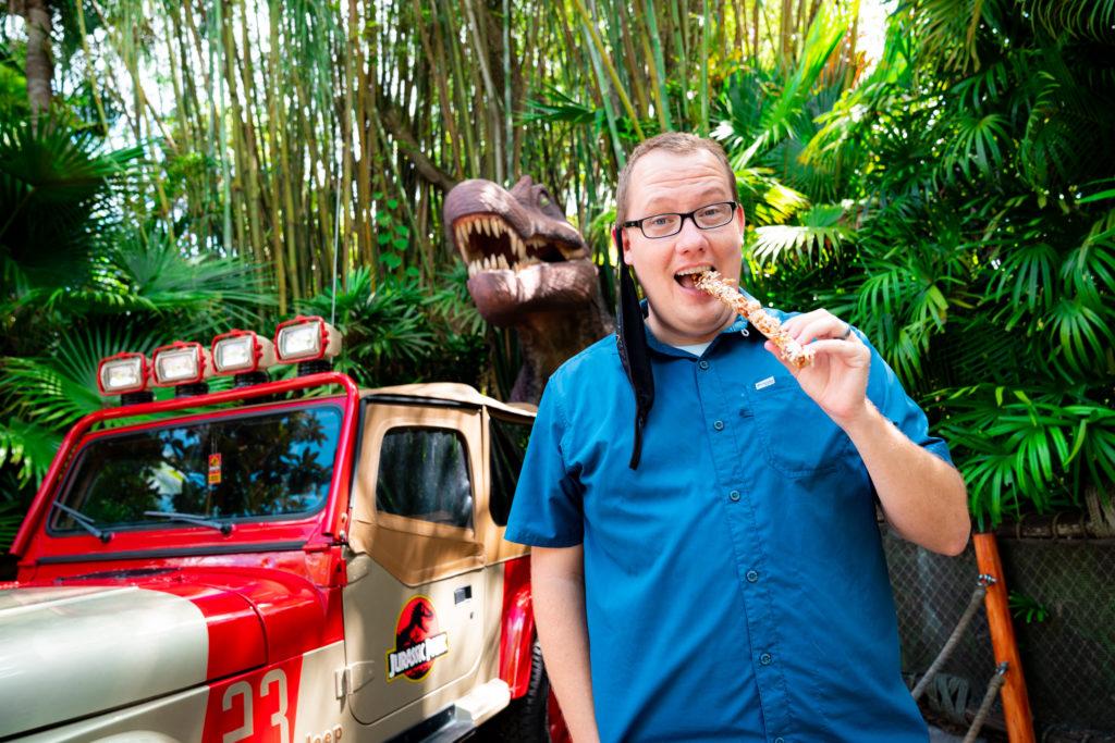 OI's own Matthew Miller enjoying a churro at Jurassic Park