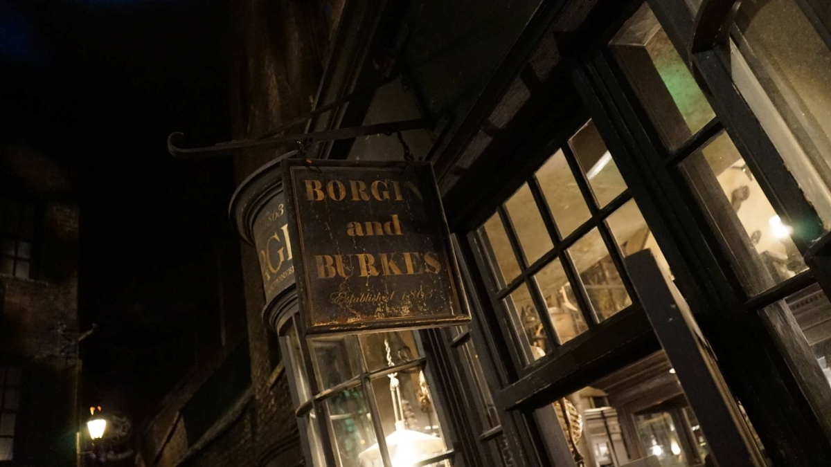 A black and gold shop sign for Borgin and Burkes in Knockturn Alley at Universal Studios Florida