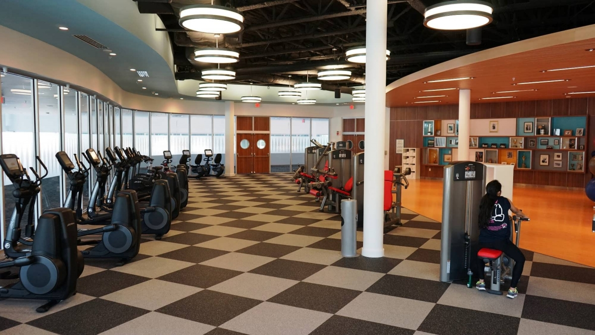 Jack LaLanne memorabilia decorates the walls, while guests get a workout on the treadmills and elliptical machines