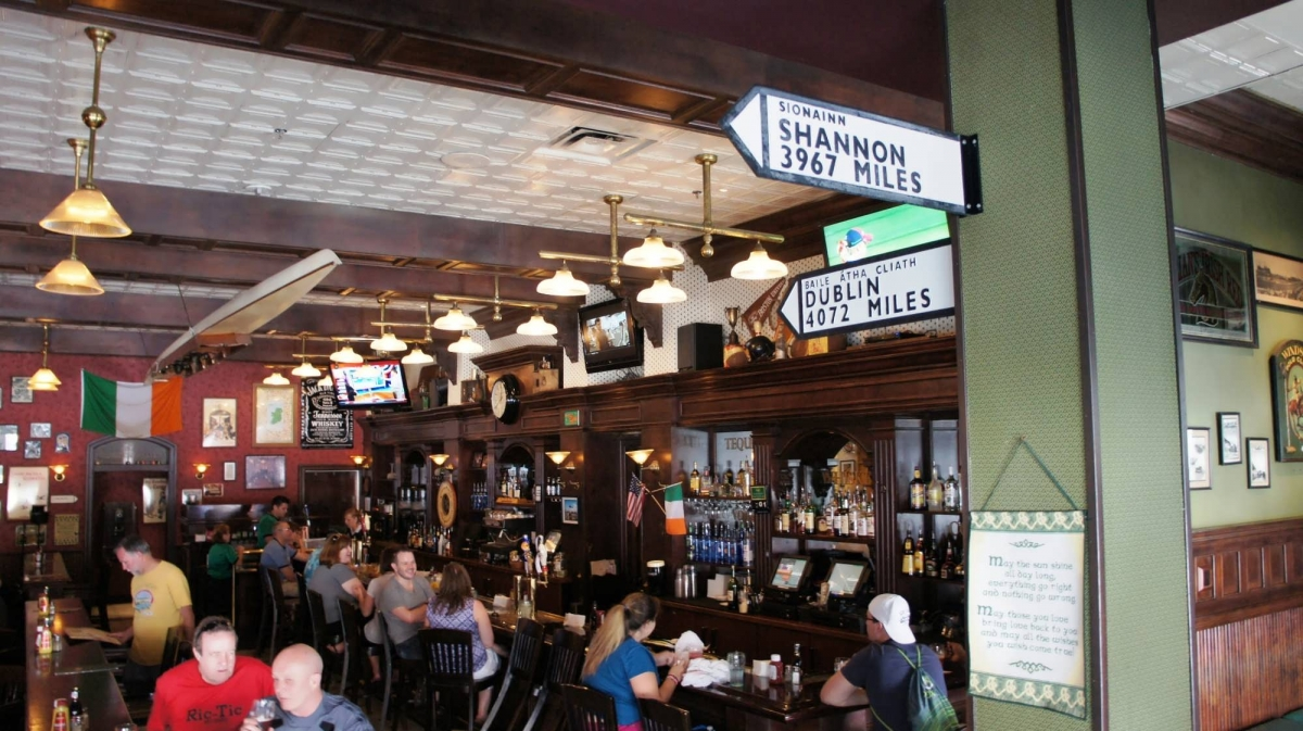 The full bar at Finnegan's is decorated with Irish bric-a-brac and signage