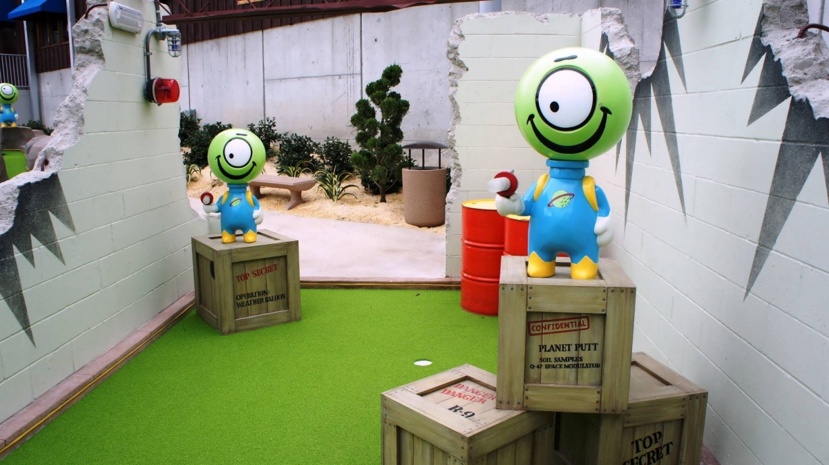 The Invaders from Planet Putt course at Hollywood Drive-In Golf, Universal CityWalk Orlando has cute little aliens