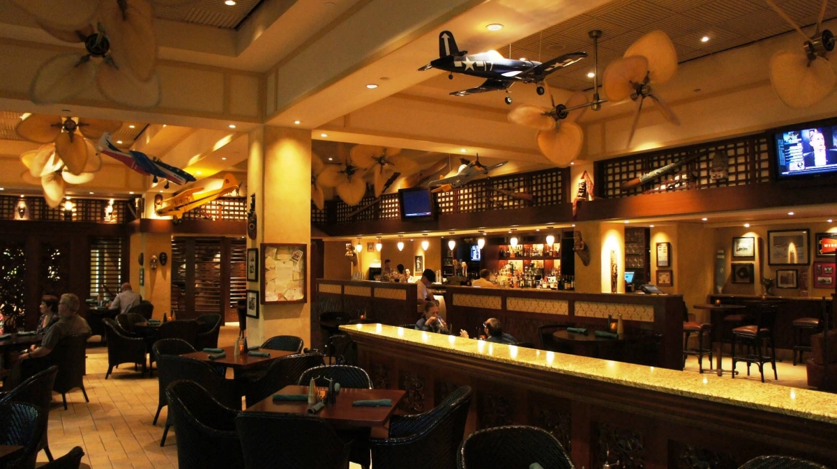 The bar and dining area of Jake's American Bar, decorated with model airplanes and other aviation memorabilia.