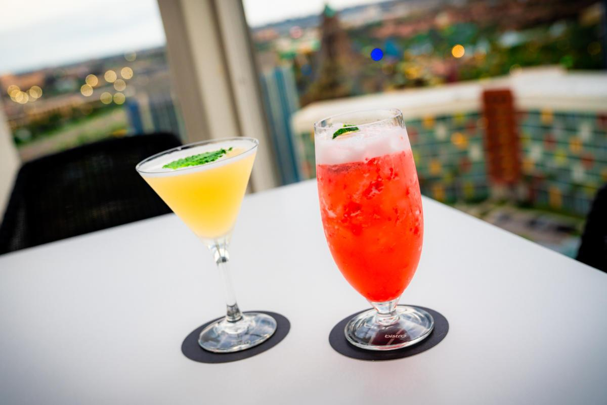 Cocktails on the 17th floor of the Aventura Hotel with a view of Cabana Bay Beach Resort and Volcano Bay