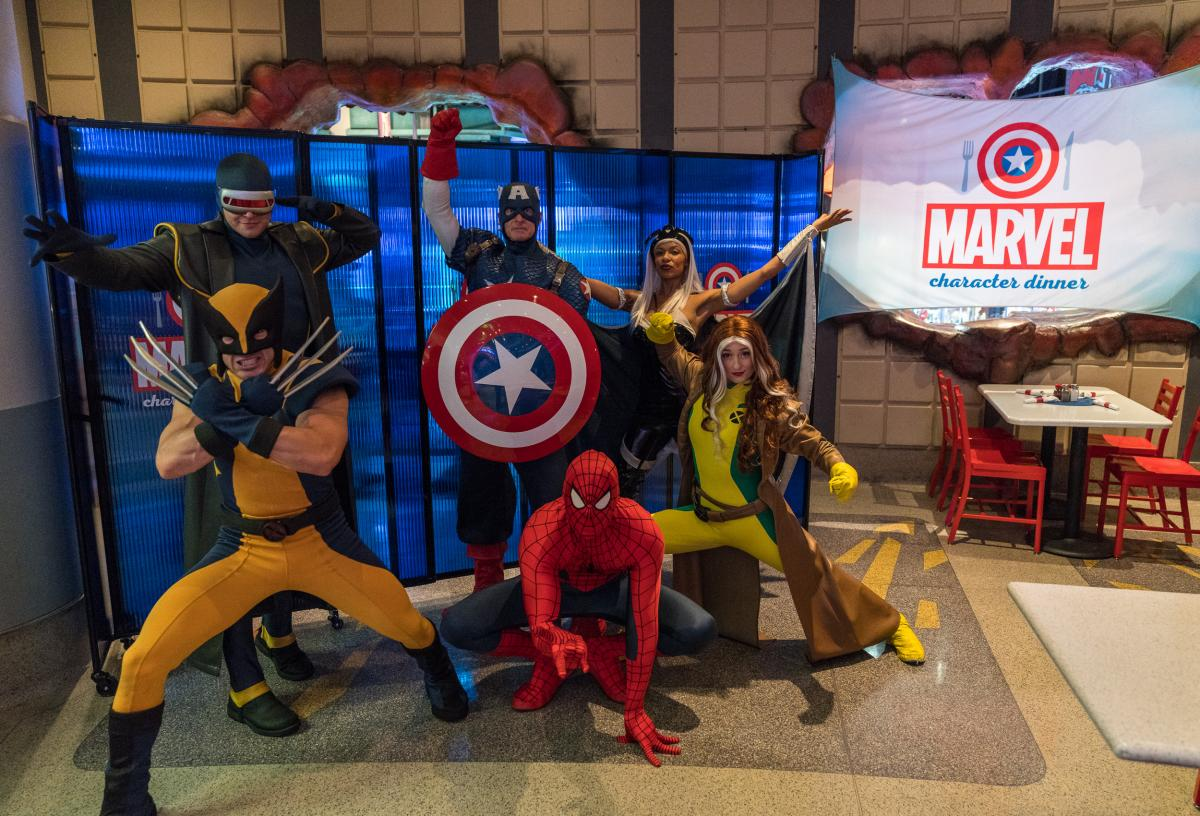 Superheroes gather at the entrance to the Marvel Character Dinner