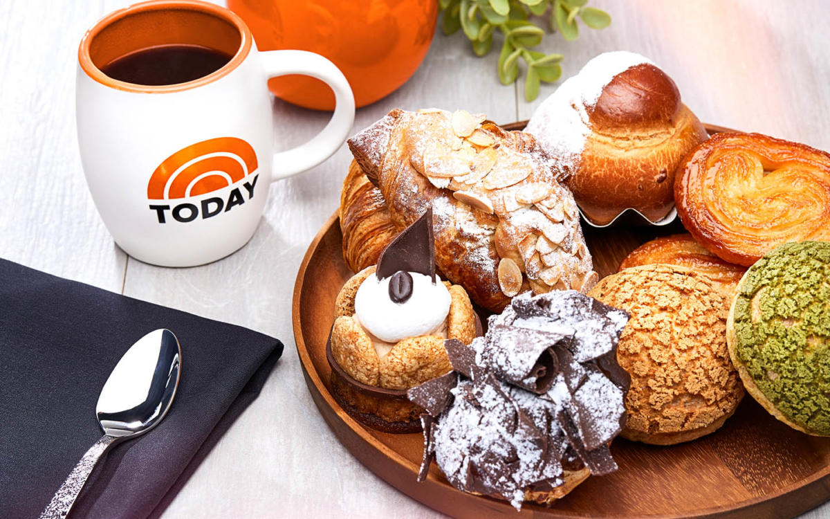 a plate of pastries and a mug of coffee from Today Cafe at Universal Studios Florida