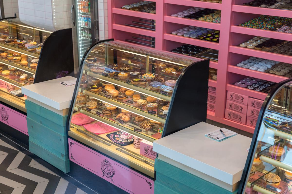 Doughnuts behind the counter at Voodoo Doughnuts