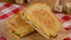 Smoked Turkey, Eggs, Swiss, Peppers, and Onions on Sourdough at Woody's Lunch Box