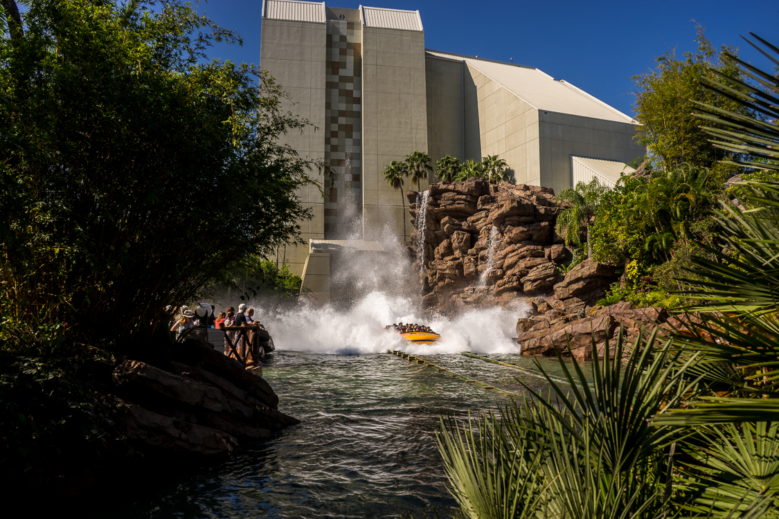 Rafts emerge from the Jurassic Park River Adventure down a huge water flume